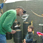 Bernie Houston of Seadrift Sculptures listens to two young boys inquiring about his art!
